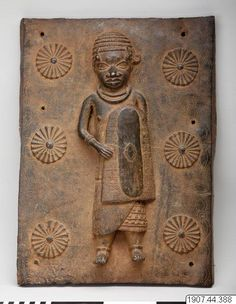 Palace guard, equipped with a shield, keeping watch over the main entrance to the royal palace. Early 17th century. (Staden-Benin) - National Museums of World Culture, Gothenburg, Sweden