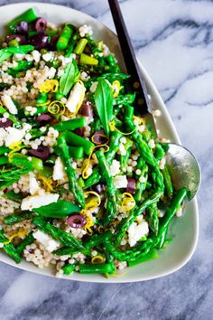 A delicious recipe for Spring Asparagus Salad with Cous Cous, kalamata olives and Mint in a zesty lemony dressing.