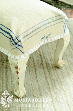So many great ideas here...an ottoman slipcover made using a vintage tea towel