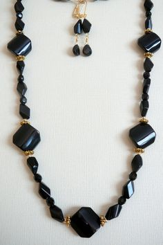 "Faceted Black 21"" - $40"