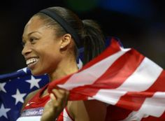 Allyson Felix of the USA celebrates her Olympic gold medal in the 200 meters, after two previous silvers.
