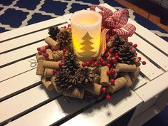 "Wine cork wreath for a coffee table decoration. I used a 10"" grapevine wreath. This will be great for my dinner table also, I'll make three to go down the middle of the table. Candle is battery powered."