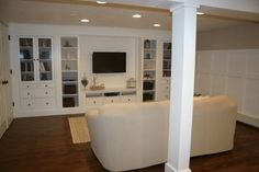 covering the support beam - Basement Renovation - traditional - basement - boston - Christina Katos