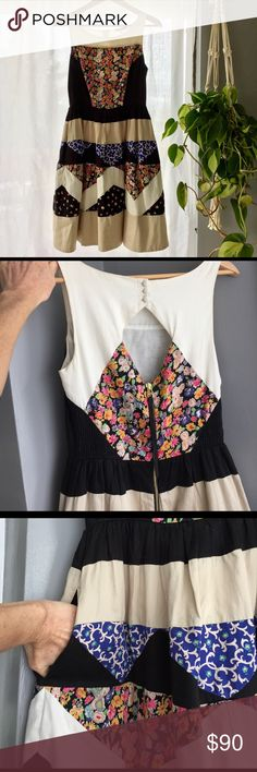 Anthropologie Leifnotes dress w/ cut out back sz2 Gorgeous patchwork dress with chevron stripe, floral print and darling cut out back. Best part? pockets!! Apron style front and a tiny touch of toile to help it flounce in just the right ways. Blacks cream, white and flowers. Anthropologie Dresses Mini