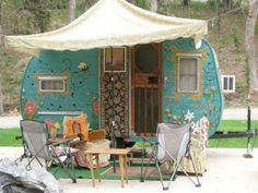 Love*love*love*love* L♥V... Travel trailer gypsy wagon turquoise with painted flowers, wooden screen door,  cloth tent and slipcovered camp chairs. Did I mention LOVE!!!!