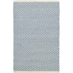 "Youll say ""Oui, oui!"" to this indoor/outdoor rug featuring a country-cool French blue and ivory zigzag pattern. Made of durable, easy-care PET, its the perfect floor covering for the kitchen, hallway, bedroom, or porch.Made of 100% PET, a polyester fiber made from recycled plastic bottles.In order to achieve its rustic charm, this rug has been woven with large-diameter yarns. Consequently, slubs, knots, and other imperfections inherent to the hand-weaving process may be more visible on this…"