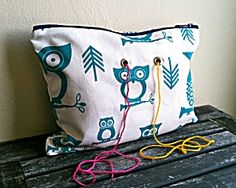 Great idea to keep the yarn tidy....but what would my cat play with now lol  Yarn Pop Bag: Turquoise Owls from Lion Brand Yarn