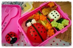 lady bird bento made from tomato and nori with a nori egg dice