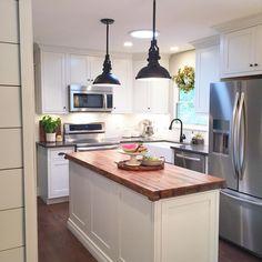 modern farmhouse kitchen - white inset cabinets, butcher block island, subway tile backsplash, farmhouse sink, shiplap