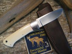 """This Ray Cover is about as good as it gets when it comes to a triditional style drop point. Ray is old school tool & die and it shows when you look over his flawless fit and finish. The blade is 3 1/2"""" long and made of ATS-34 stainless steel. The bolsters are stainless and the tapered tang handle has wonderful red stag with a four stainless pins and a fine black liner between the slabs and tang. Overall length is 8 1/2"""". Comes in a hand made to fit pouch sheath."""