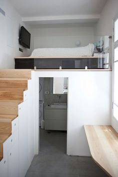 En suite under mezzanine bed. Would need tall room to be able to stand up in both bathroom and bed areas!