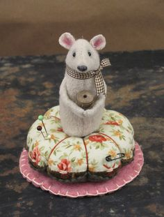 The cuteness of this pin cushion could make me feel the need to own a pin cushion!!