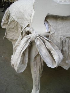 Ruffles for a linen seat cover, so sweet.