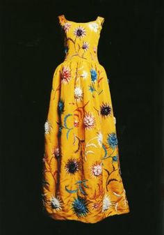 This exquisite Balenciaga dress from 1961. I counted 20 flowers on the front of this beautiful dress. Assuming the back has the same number of flowers, there would be approximately 40 flowers on the dress. If each flower takes between 3-6 hours to embroider, that is 120-240 hours of embroidery work!!! No wonder haute couture dresses are so expensive!  from Fashion is my Muse. Ingrid Mida