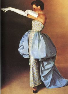 1951 Bettina in pale grey satin strapless gown embroidered in gold and adorned with pale blue taffeta tunic by Balenciaga, photo by Philippe Pottier