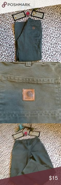 Men Carhartt Carpenter work pants Men carpenter Carhartt work pants. Green in color. Guc. No rips, tears, a few small stains. Doesn't fit hubby, he's a 31 W. I think it's a 32/33 W. No tag inside. Pockets in front & back. Carhartt Jeans