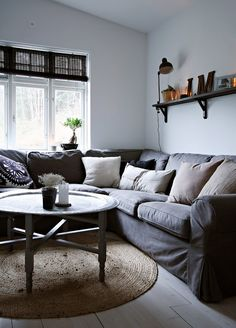monica bromseth scandinavian home. Round rug, round coffee table.looks so cozy!