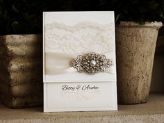 Beautiful Vintage Wedding Invitation from www.stephita.com. They carry a lot of lace wedding invitation styles and wedding invitations with broaches.