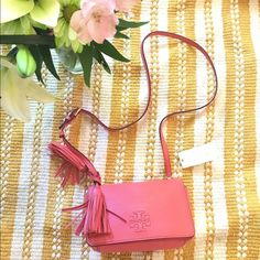 """HPTory Burch Thea Mini Leather Tassel Beautiful Authentic Tory Burch Coral Tassel Crossbody!  Great condition! Never worn! Removable straps, the strap is about 23 inches long! The measurements are 8.5""""W x 5.25"""" H x 3.25""""D! Gold tone hardware! Magnetic Flap. Perfect for spring! Dust bag included! Smells brand new! Retail $395. Plus tax! Price is Final! Tory Burch Bags Crossbody Bags"""