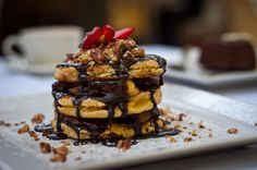 Best Pancakes in town - gingko coconut flapjack stack w chocolate sauce & bananas Caramelized Bananas, Breakfast Menu, Waffles, Pancakes, Menu Items, Coconut, Chocolate, Summer, Food