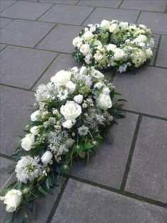 White single ended spray and wreath to go on top of a coffin.