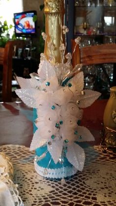 These Will Be The Tall Centerpieces Except Clear Vases With Black Water And Turquoise Feathers