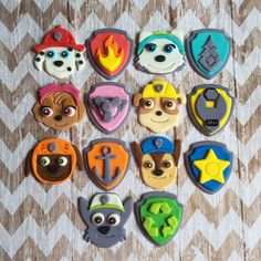 12 Fondant Paw Patrol cupcake toppers pups and/or shield badges by SweetCakeArts on Etsy https://www.etsy.com/listing/289364623/12-fondant-paw-patrol-cupcake-toppers SweetCakeArts