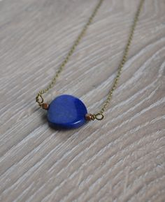 """This lapis stone necklace comes with copper metal beads and a delicate brass chain. I love the color of lapis stones because of the dark navy color and the flecks of gold with in the stone. If you need a different length chain please let me know.  Size Pendant: 2cm Chain: 18""""  Enter shop he..."""