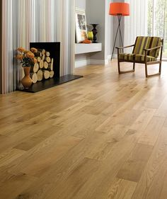 Solid Easy-Fit Oak Hardwood Flooring - Topps Tiles - £38.99pm2 - 18mm thick - can't use next to a log burner though...
