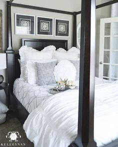 Kelley Nan (@kelleynan) • Instagram | Black and white guest bedroom inspiration with canopy bed and white plush bedding | white and gray quilt with Pottery Barn Hadley Ruched duvet