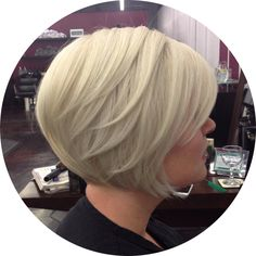Platinium blonde with a graduated Bob. Lots of texturizing and weight removal. Short hair with side bangs.