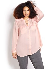 Refresh your work wardrobe with this long and fluid blouse by Michel Studio featuring a mandarin collar and a high central slit at the back. Plus size, long button cuff sleeve, button tab shoulders, front button closure, 2 chest pockets, rounded high-low shirt tail hemline. 32 inch front length; 35 inch back length.