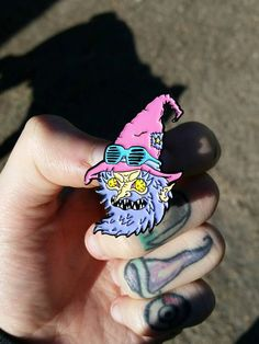 1 inch soft enamel genuine Wizard pin with butterfly clutch backing. Garunteed to make you look super cool. Limited to 100 pieces
