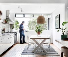 Russel Koskela enjoying a hot drink in the kitchen / dining area of his home in Sydney.