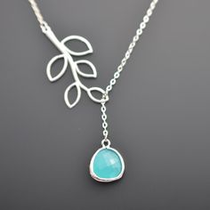 I may have to get this!  Aqua Blue Glass  teardrop and branch neckalce by LilliDolli, $22.00