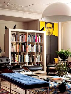 The Eames chair always looks perfect surrounded by books! I must have one!