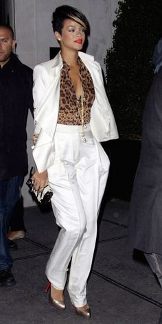 In a comparatively tame take on the menswear-inspired trend, Rihanna looked glamorous on the streets of Manhattan in 2009 in a crisp white suit and flame-red lip.