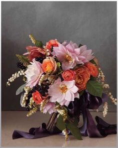 Rich colors for a fall wedding bouquet. Peach, eggplant, orange and white!