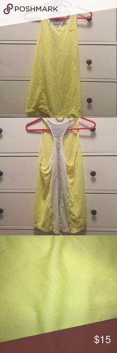 Nike workout tank top Nike Workout tank top. Yellow with white and grey back. Size M. There is two small snags on the front. Very small and can barely notice. Nike Tops