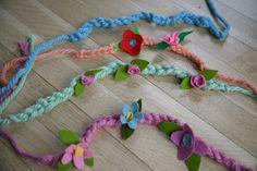 Yarn braid headband with felt flowers.