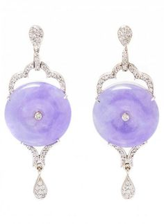 A Pair of 18 Karat White Gold, Lavender Jadeite Jade and Diamond Earrings, containing two lavender jadeite jade bi disks measuring approximately 17.70 mm in diameter and numerous round brilliant cut diamonds weighing approximately 0.44 carat total.