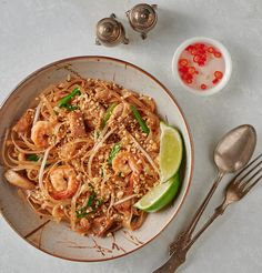 Easy pad Thai table scene from above. You may really like this hack of a classic dish. Easy Pad Thai, Sambal Oelek, Marinated Tofu, Asian Market, Well Seasoned, Rice Noodles, Fish Sauce, Learn To Cook, Cooking Classes