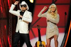 Carrie Underwood (Jovani style 5278) and Brad Paisley
