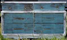 Shabbied dresser with white and blue