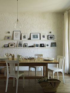 norden dining table with white chairs. (and I love that photo display)