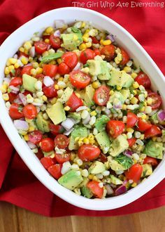 2 cups cooked corn, fresh or frozen (see Note) 1-2 avocados, cut into 1/2-inch cubes 1 pint cherry or grape tomatoes, halved 1/2 cup finely diced red onion Dressing: 2 tablespoons olive oil 1/2 teaspoon grated lime zest 1 tablespoon fresh lime juice 1/4 cup chopped cilantro 1/4 teaspoon salt 1/4 teaspoon pepper