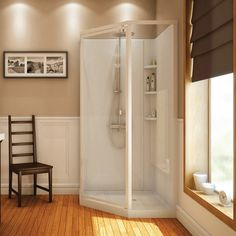 this corner shower stall has builtin shelves and towel bar for storing all your bathroom necessities and a textured bottom for added safety