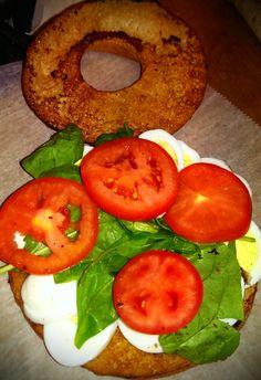 Toasted Sesame Flagel with sliced hard boiled eggs, spinach and ripe tomatoes!