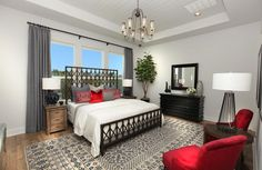 Red and blue master bedroom with tray ceiling; The Archer floor plan, Drees Custom Homes, Austin
