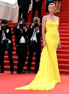22 of the Most Memorable Style Moments in Cannes Film Festival History | People - Charlize Theron in a yellow Dior Haute Couture